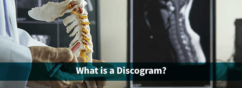 doctor with spine model explains need for discogram to patient